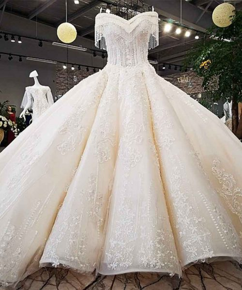 ivory off shoulder sweetheart ball gown